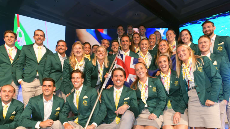 Hockey captain Mark Knowles (centre) poses for a photograph with members of the Australian Commonwealth Games team.