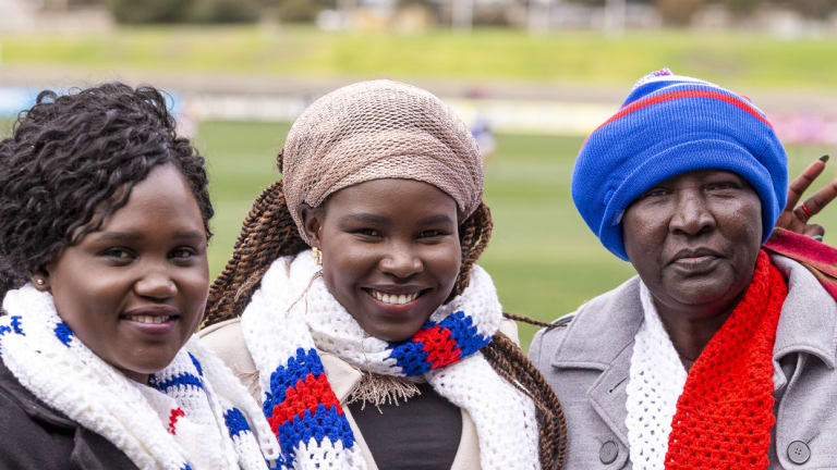 Ayak Alier with Yier Andrew , and Agostina Nyibol at the Ujamaa Community Festival at Whitten Oval.