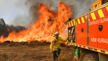 NSW RFS firefighters battle the bushfire on Long Gully Road at Drake on Monday.