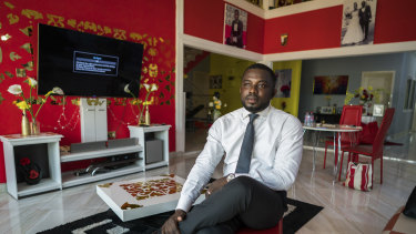 Richard Nunekpeku, who left a high-paying job at Samsung to raise fowl, cereals and vegetables, in Oyarifa, Ghana.