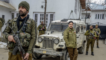 Officer Ashiq Tak, centre, with his bodyguards outside his office in Shopian, India, in the state of Kashmir. As the commanding officer of a tactical police unit in southern Kashmir, he is one of hundreds of thousands fighting a tiny but dedicated insurgency.