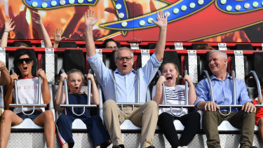 Prime Minister Scott Morrison with daughters Lily, Abbey and Deputy Prime Minister Michael McCormack at the 2019 Royal Easter Show.