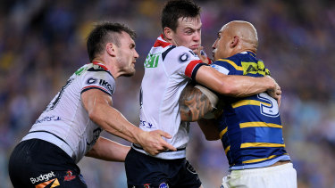 Keary aims up with the Eels' Blake Ferguson during the Roosters win on Friday night.