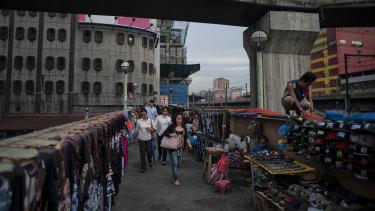 Street hawkers on an overpass above Epifanio de los Santos Avenue in Manila. The decades of democracy have not alleviated the plight of the poor.