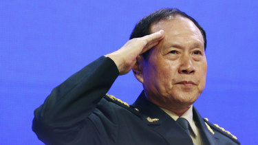 Chinese Defence Minister General Wei Fenghe salutes attendees of the ShangriLa forum in Singapore.