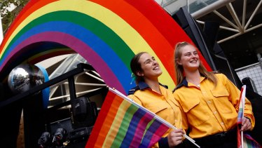 Sisters Gabrielle and Katherine Tanks from the North Rocks Rural Fire Service attend their first Mardi Gras.