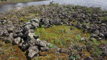 The remains of an ancient Indigenous stone house at Lake Condah, part of the Budj Bim landscape.