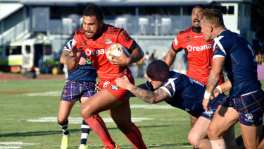 Strife: Tonga's Peni Terepo breaks the Scottish line during the 2017 Rugby League World Cup.