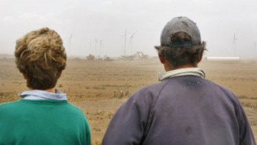 Ann and Gus Gardner watching on in March 2012 as construction of the Macarthur Wind Farm takes place next to their land.
