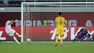 Out of nowhere: Omar Al Somah converts the contentious penalty awarded to Syria against the Socceroos.