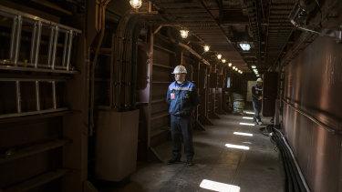 Technical staff in the corridors on the ground floor of the Akademik Lomonosov.