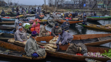 Vendors at a floating market in Srinigar, India, in the state of Kashmir.