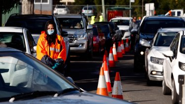 Cars queued for nearly a kilometre to attend a pop-up mobile clinic in Victoria Park, Picton.