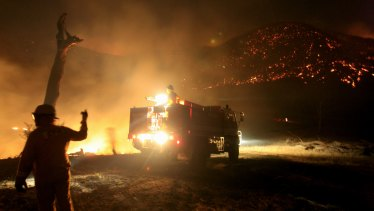 CFA members battle the Beechworth fires.