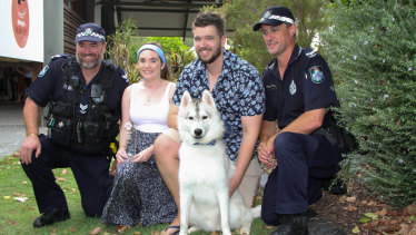 Max with owners David Symes and Shaune Martin, and the first police respondents to the scene.