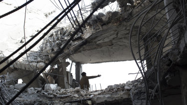 The aftermath of an air strike that killed seven people in Sanaa in September 2015.