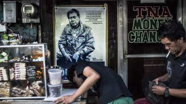 'A leader must be a terror to the few who are evil': A poster for President Duterte on the window of a store in Manila.