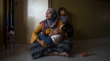 Siti Nor Azila, the second wife of Che Abdul Karim Che Abdul Hamid, with her two daughters in her family's home in Gua Musang town in Kelantan, Malaysia.