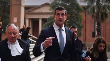 Bruce McClintock, SC, left, with Ben Roberts-Smith outside court last week.