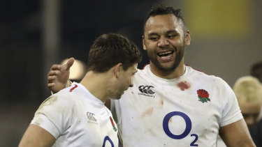 Momentum: England's Billy Vunipola (right) celebrates with teammate Ben Youngs after the win against Ireland.