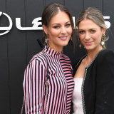 Channel Nine reporter Madeline Slattery (left) and her sister Eloise are seen in the Lexus marquee.