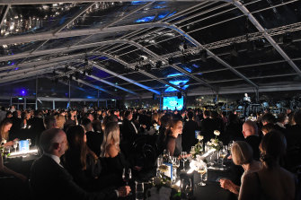 Culbert addresses guests in a gigantic marquee at the gala dinner.
