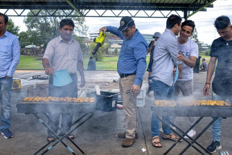 A law of the Australian barbecue: men must cook the meat: in this case, kebabs.