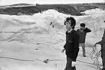 "The artist Christo and his assistants during the ""wrapping"" of Little Bay on October 9, 1969."