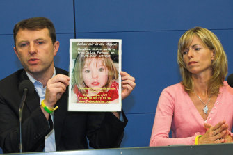 Gerry, left, and Kate McCann, parents of Madeleine McCann, missing from the Portuguese town of Praia da Luz, present a picture of their daughter in Berlin in 2007.