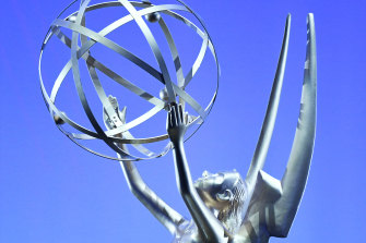 The muse of art, upholding the electron of science, also known as the Emmy.