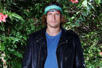 Model David Genat, based in New York, makes his reality TV return in Survivor: All Stars.