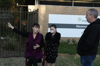 Relatives of Newmarch House residents outside the home on Tuesday: Liz Lane with daughter Samantha and Anthony Bowe.