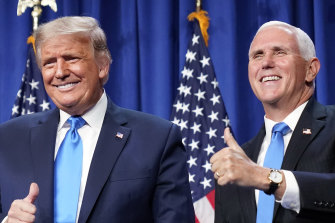 US President Donald Trump and Vice-President Mike Pence on stage at the RNC in Charlotte, NC.