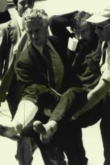 The 1977 capture of Edwin John Eastwood, seen here being carried from a plane at Essendon Airport, enhanced Miller's reputation.