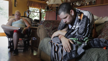 Dylan Nelson, of Burlington, Wisconsin, right, was rushed to the hospital in June by his sister, left, with severe breathing problems. Doctors believe he and two dozen other young adults suffered serious lung injuries after vaping nicotine or THC, or both.
