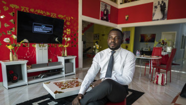 Richard Nunekpeku, who left a high-paying job at Samsung to raise fowl, cereals and vegetables, in Oyarifa, Ghana.