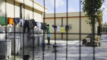 A man does his laundry in a temporary holding centre for immigrants in Ceuta, Spain.