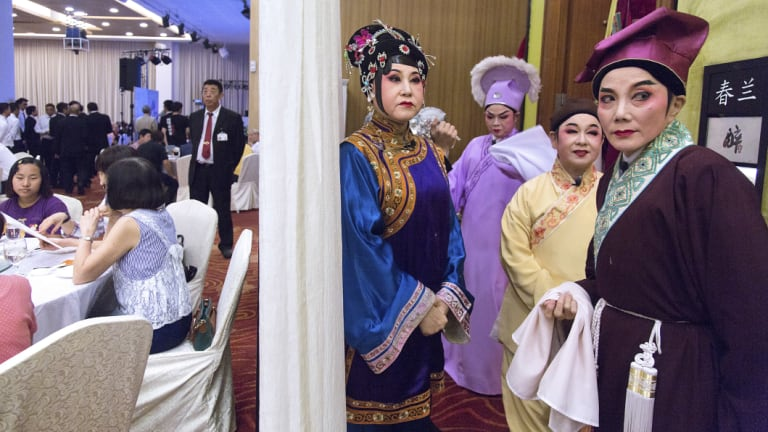 Members of the Nam Hwa Opera, a Teochew opera group, get ready for a performance in Singapore in May at a club for Singaporeans with ties to China's Guangdong Province.