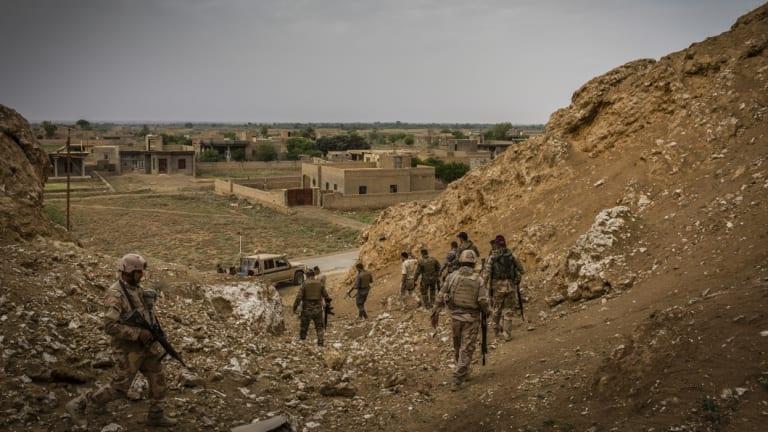 Iraqi border guard troops patrol the Syrian border near Qaim, in April.