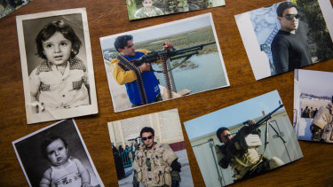 Photographs of Captain Harith al-Sudani are laid out at his family's home in Baghdad.
