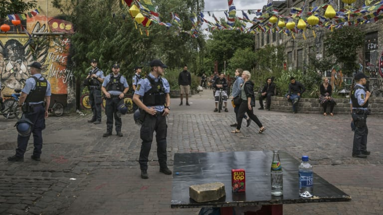 Police officers search for hashish and marijuana at Pusher Street in Christiania Freetown, the hippie commune in the centre of Copenhagen, Denmark.