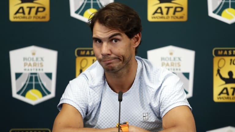 Nadal addresses the media after his withdrawal from the Paris Masters.