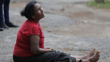 A relative of a blast victim grieves outside a morgue in Colombo, Sri Lanka.