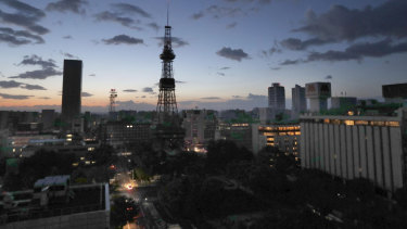 Sapporo TV Tower, centre, and other buildings lose power after an earthquake in northern Japan,