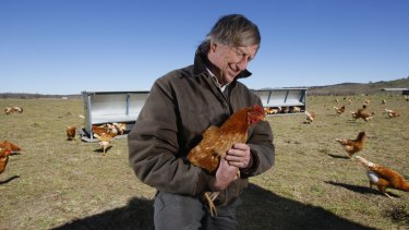 Tony Coote with his free range chickens in 2009.