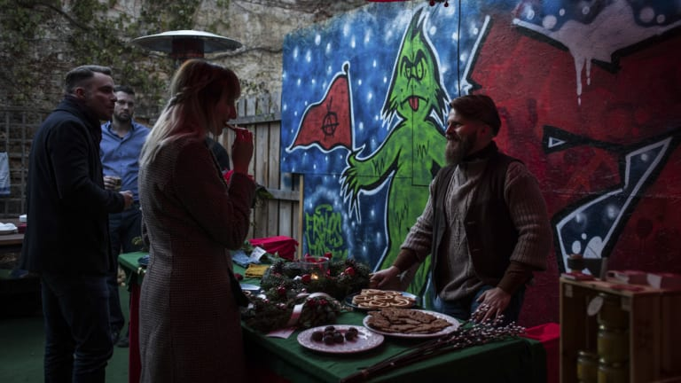 Alex Malenki, right, and his wife, Ingrid Weiss, at a Christmas market hosted by Generation Identity, a far-right youth movement, in Halle, Germany.