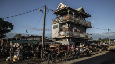 A so-called vanilla mansion looms above a street in Antalaha, Madagascar.