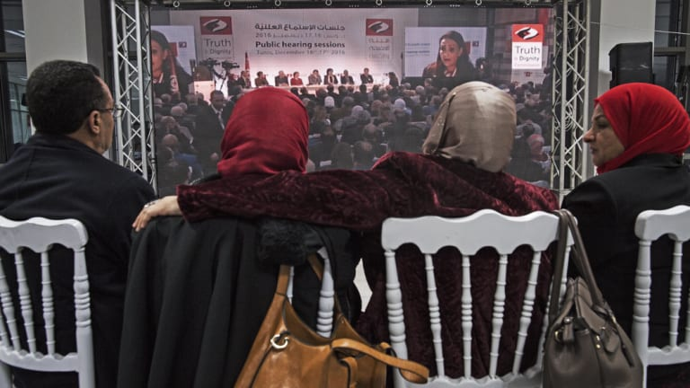 Hamida Ajengui, centre left, a former Islamist activist tortured under Zine al-Abidine Ben Ali's dictatorship, listens to other victims at the Truth and Dignity Commission in 2016.