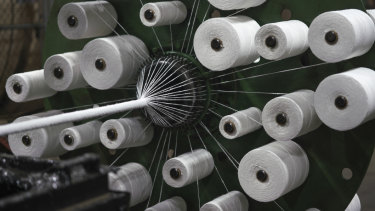 Nylon is wrapped around fibre-optic cables at the SubCom factory in Newington, New Hampshire.
