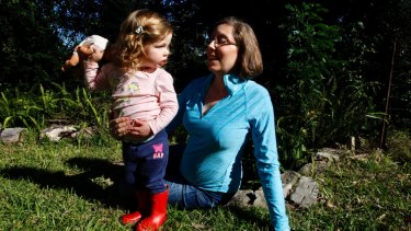 Kathy and her two-year-old daughter Emma in their home in Hornsby.